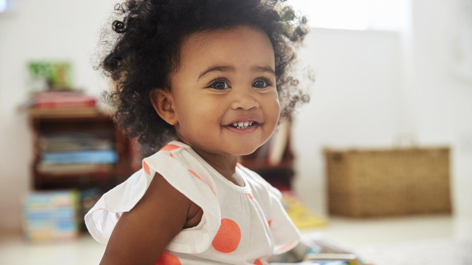 litte girl smiling
