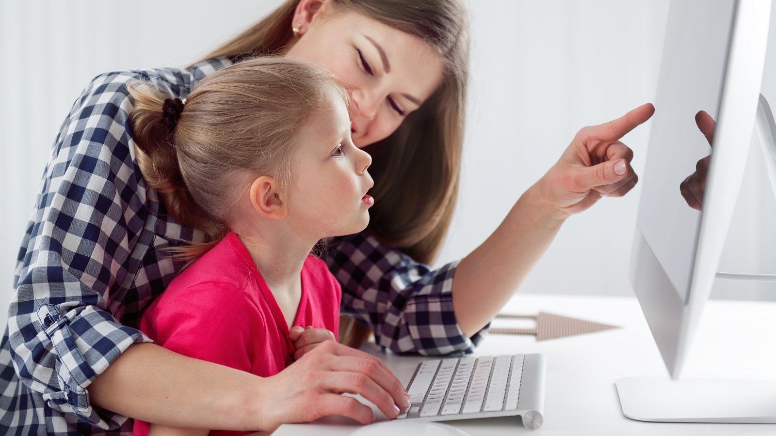 mother and daughter using computer together