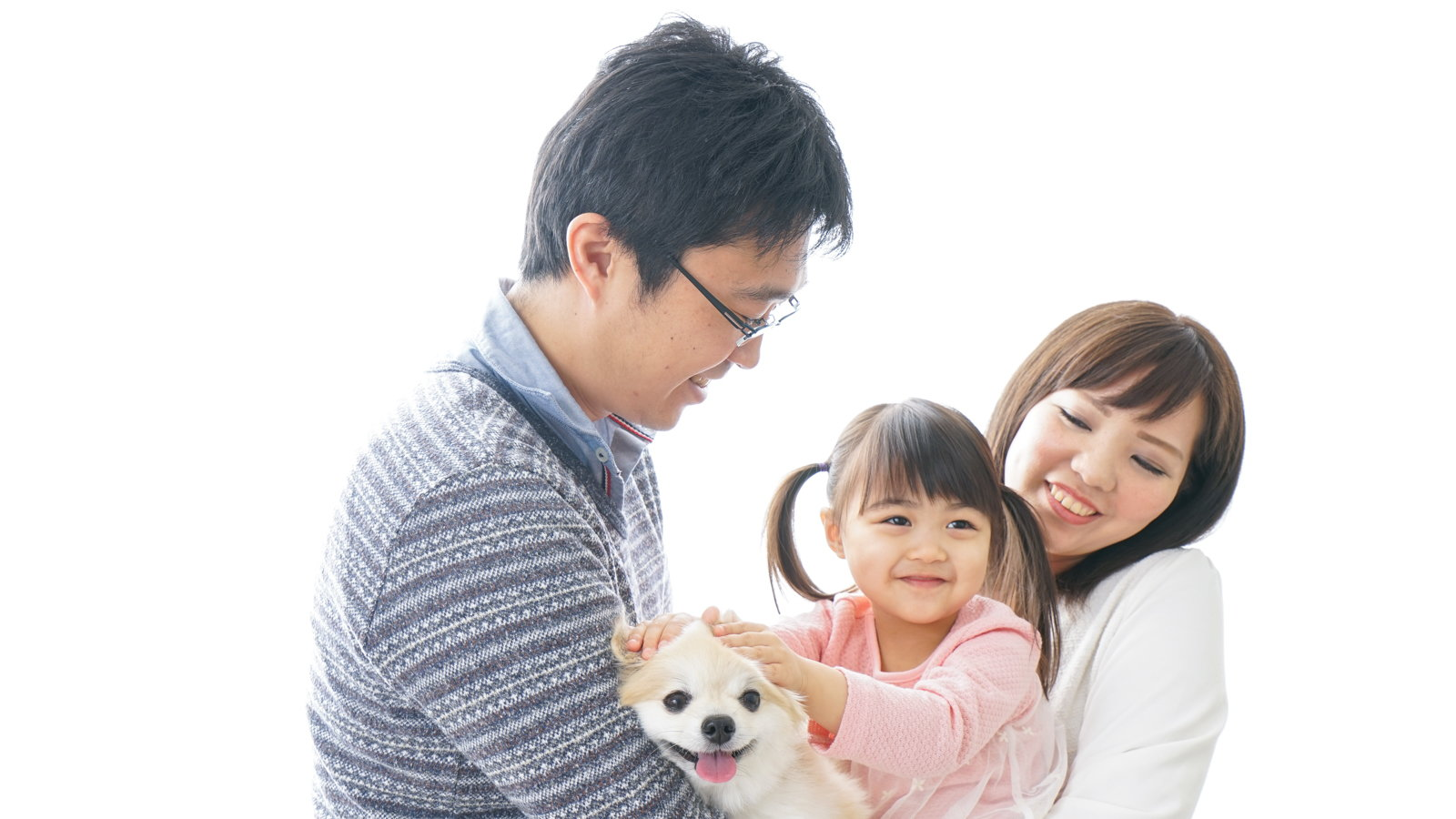 mom and dad holding girl and dog