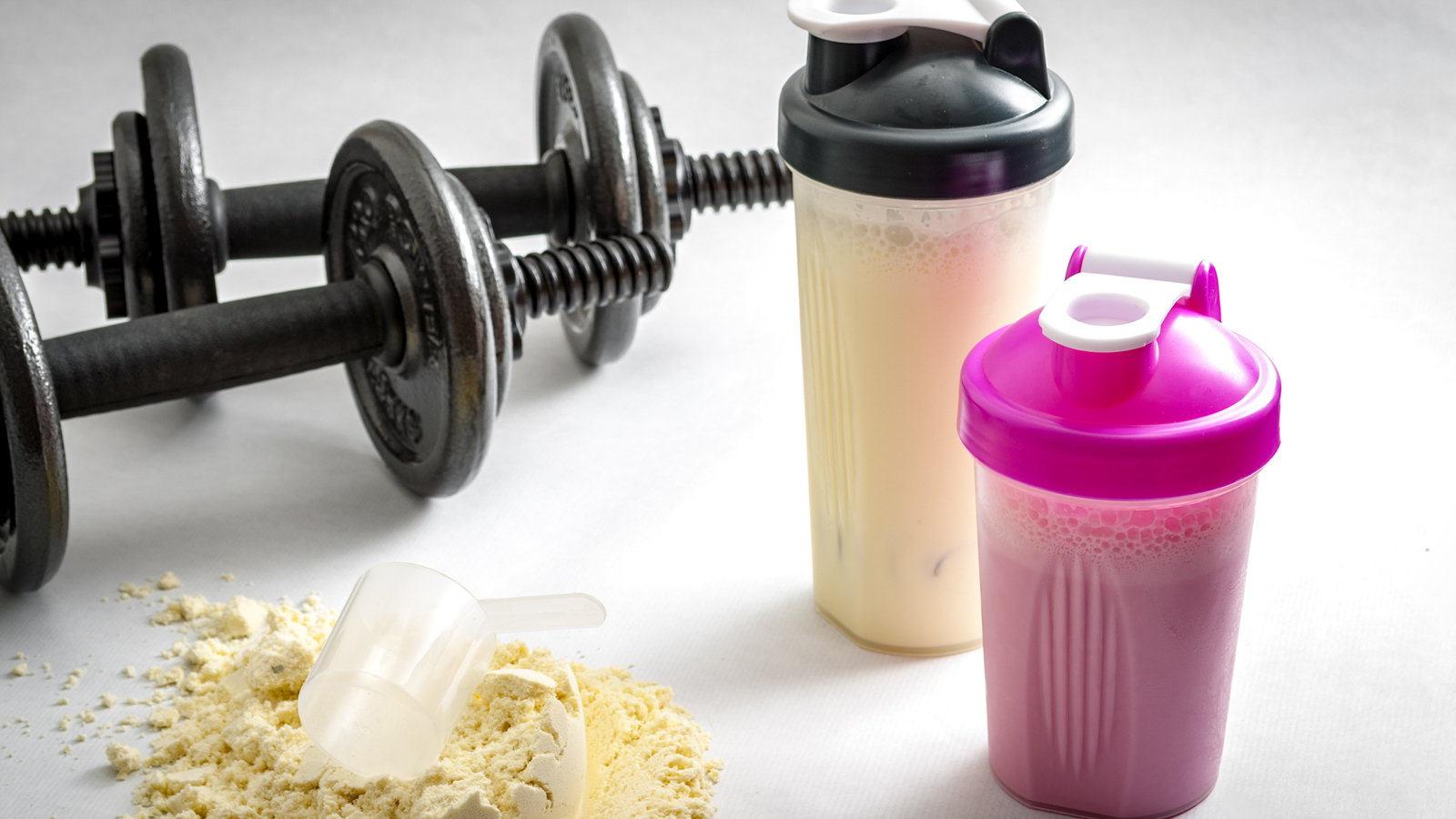 adjustable dumbbells and protein shakes