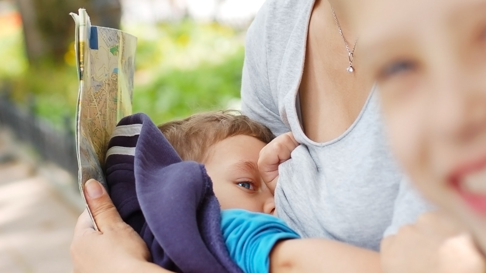 woman breastfeeding toddler