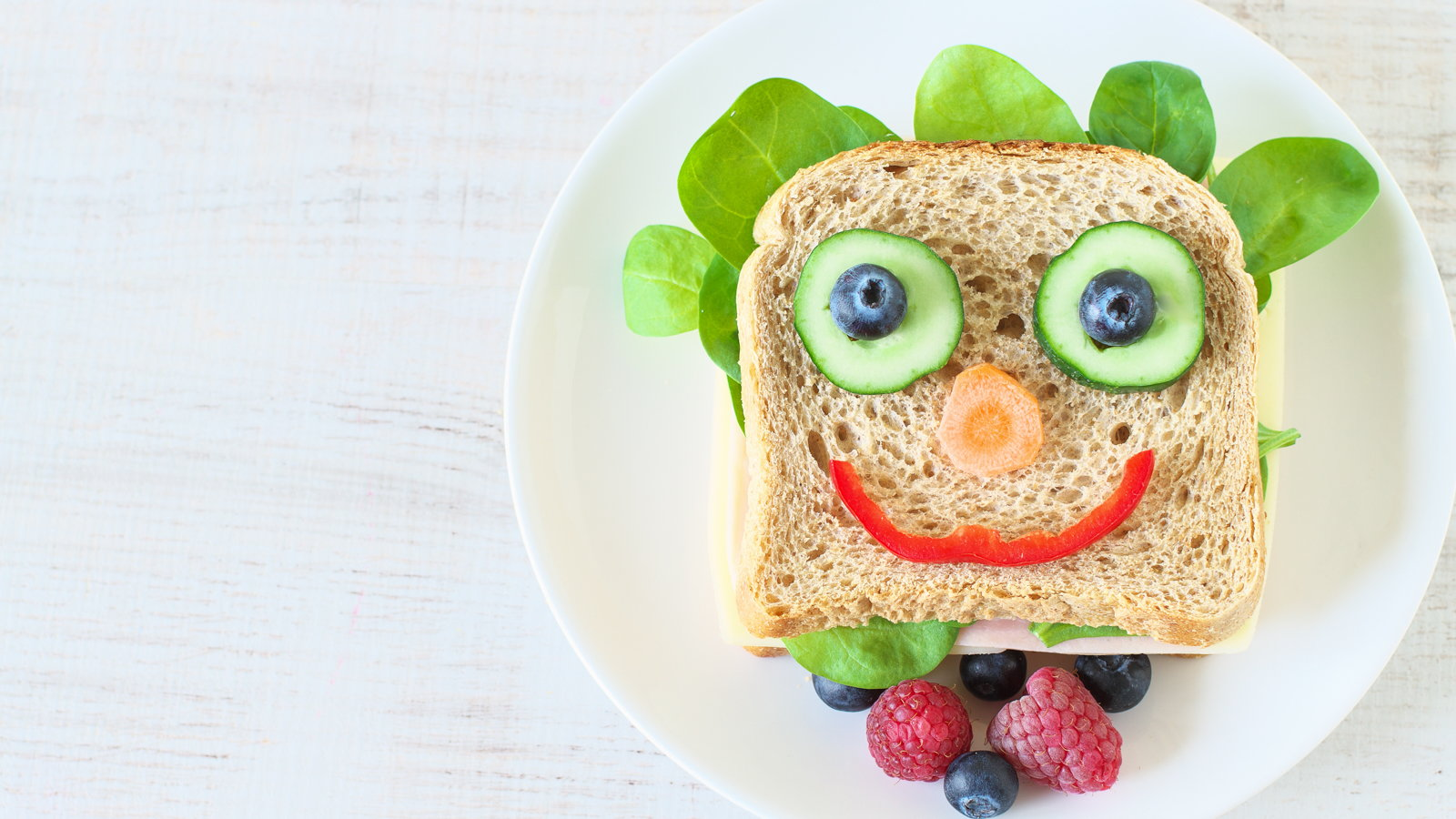 sandwich with a veggie smiley face