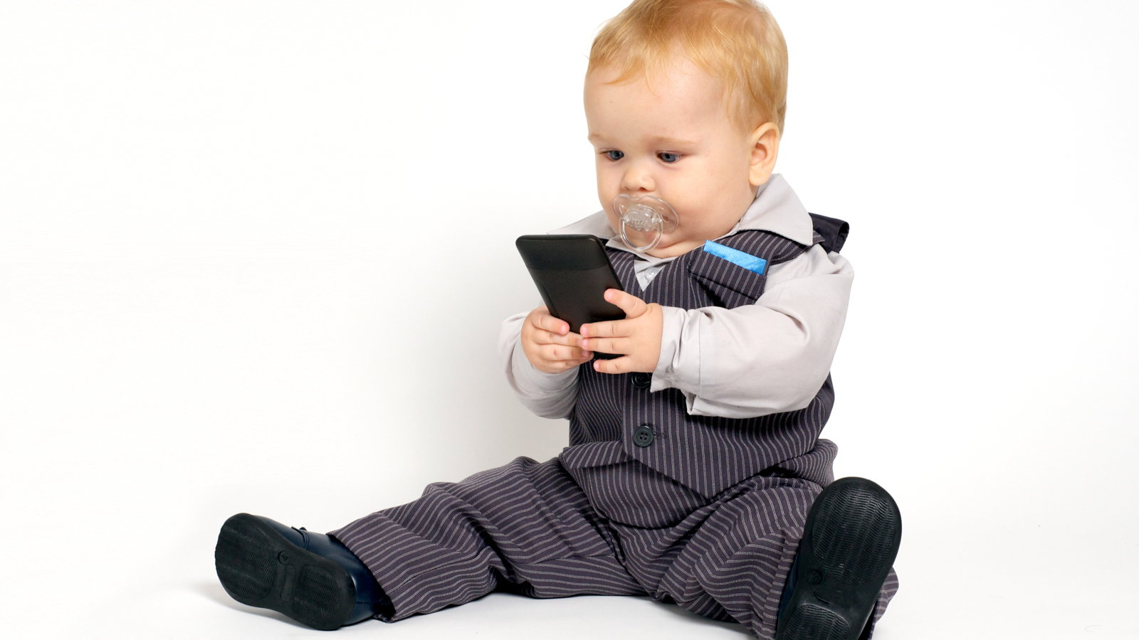 baby playing on smartphone
