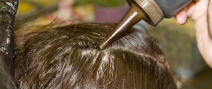 bottle of air dye on scalp