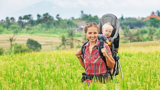 mother wearing baby in a carrier on her back