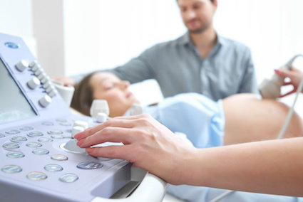 young couple looking at ultrasound