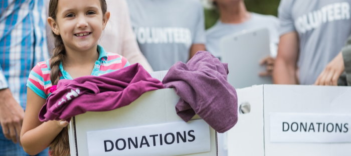 child carrying a box of donations
