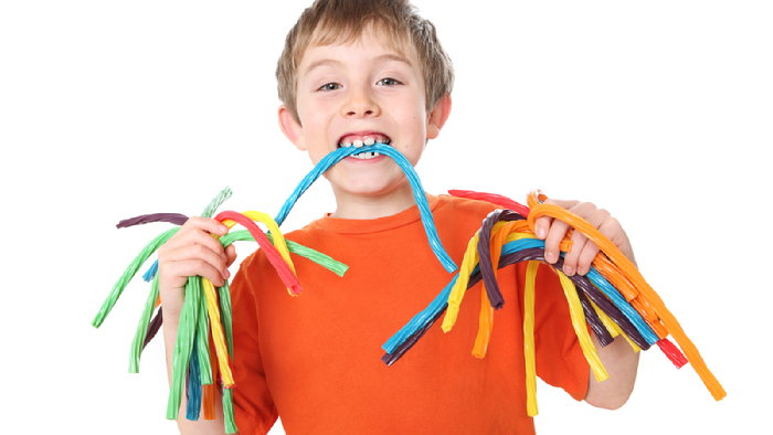 boy with colorful candy ropes