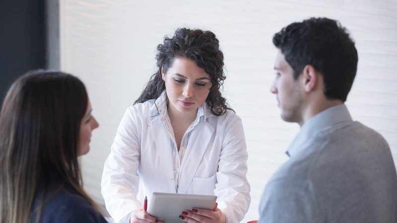 Couple consulting with doctor