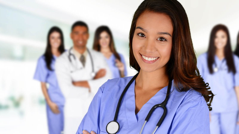 Nurse with nurses and doctor in background