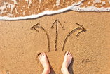 feet in sand with multiple arrows