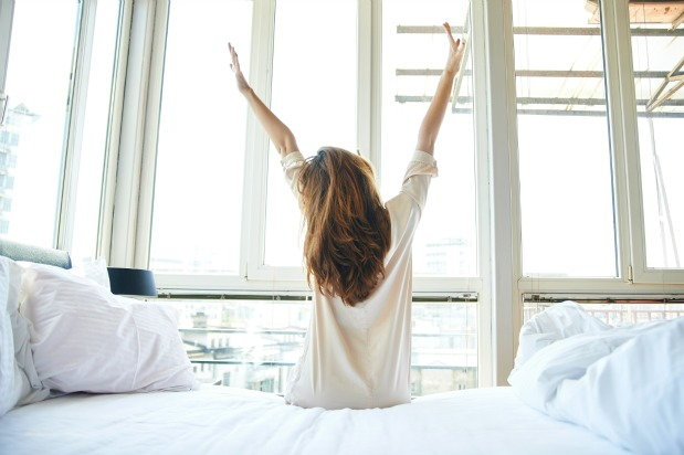 woman wakes up happy