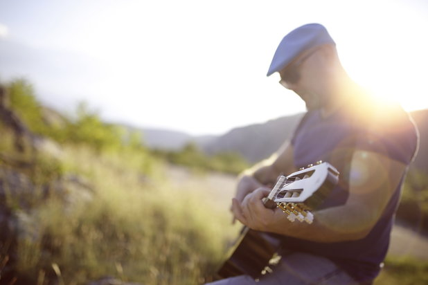 Man enjoys his own company as he indulges in guitar hobby
