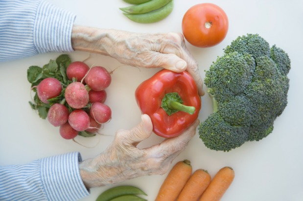 elderly person handling vegetables