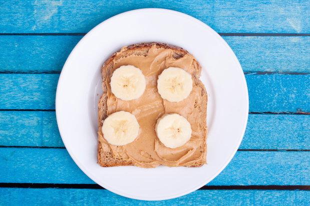 open faced peanut butter and banana sandwich