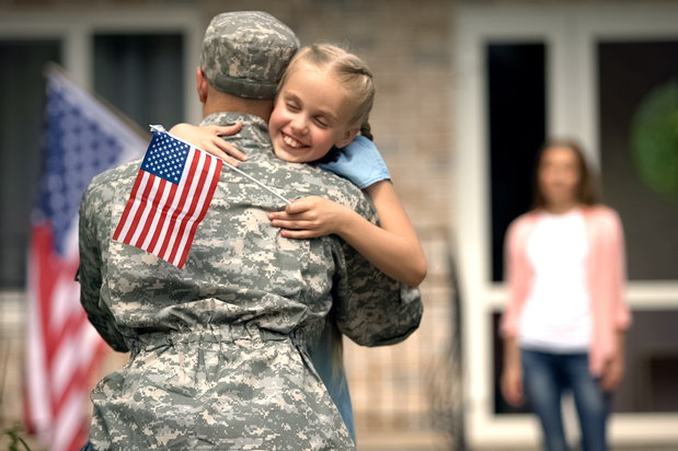 military personnel leaves his family for deployment