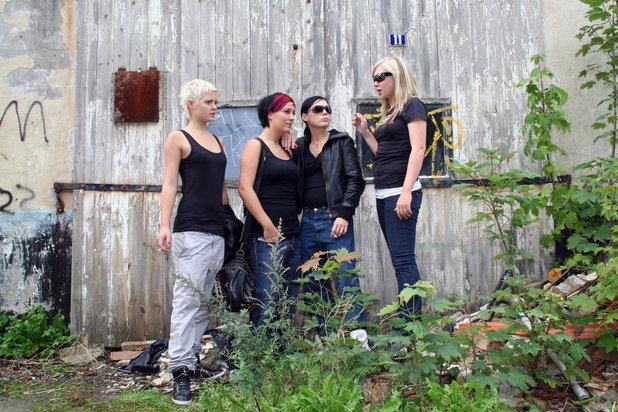teenage girls hanging around smoking cigarettes