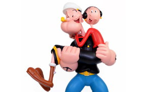 Toy Popeye lifts Olive Oil with his muscular arms.
