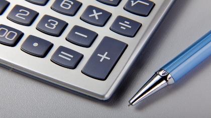 A calculator and a pen.