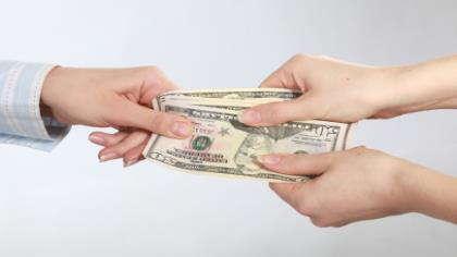 Money exchanging hands.
