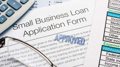 Paperwork for an approved business loan.