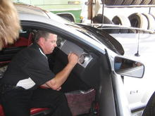 Chip Foose signing cars at the Last Ciener-Woods Ford Mustang Show.  That's one of my customers cars. 9-07