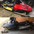 Two Asphalt sled / snowmobile