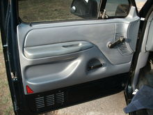 Here's some fresh picks of me installing anti slim jim (slimjim) panels into my 92 Ford F-150. The whole procedure didn't take as long as I thought it would. Removing the inner skin along with the arm rest is half the work. Tools needed is a 12''x24'' sheet of galvanized metal, a pare of tin snips, a box of rivets, a hand held rivet gun, a drill and a few bits. The idea of the installation is to keep out intruders using a slim jim to snatch your ride. We have all seen that guy around the corner with his slim jim kit just waiting to show you how fast he can get in your truck, or at least I have. I don't know about you, but for a few buck worth of hardware and dads borrowed tools you can turn your ride into a fortress. What I did was easy and you can do it to. What you want to do is slide the metal sheet in the hole of the door and use it to guard the door pin rod on all sides creating a barrier around the rod making it impossible to be hooked from the outside. Before you mount it in place make sure the metal sheet is not interfering with the window rolling up or down. One more thing, before you start this installation make sure you have a spare door key somewhere hidden outside the truck or at least at home. If you get your keys locked in with anti slim jim panel's installed you will have to break the glass to get in! To all you die hard F-150 guys out there get back at me and post some photos if you did the same thing, I'd like to see your end results.