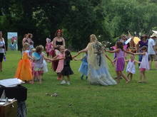 Dancing lessons from the Fairy Queen (Matilda and Adelaise are in white/light pink 2 and 3 on the right side of the Queen, Eveln has a purple, yellow and pink floral dress and blue wings 2nd on the left from the Queen)