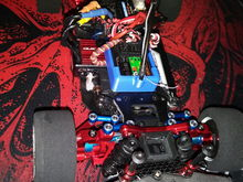Latrax rally after aluminum upgrade. Front and rear arms and hubs, front hub carriers, shock towers, and front/rear bumper/body post mounts. Added exactly 1 ounce of weight according to my scale. Doesnt seem like a bad trade for the durability imo.