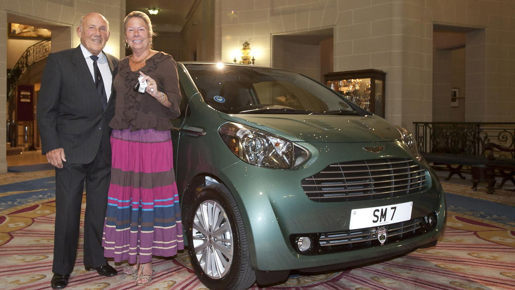 Sir Stirling Moss and his new Aston Martin Cygnet