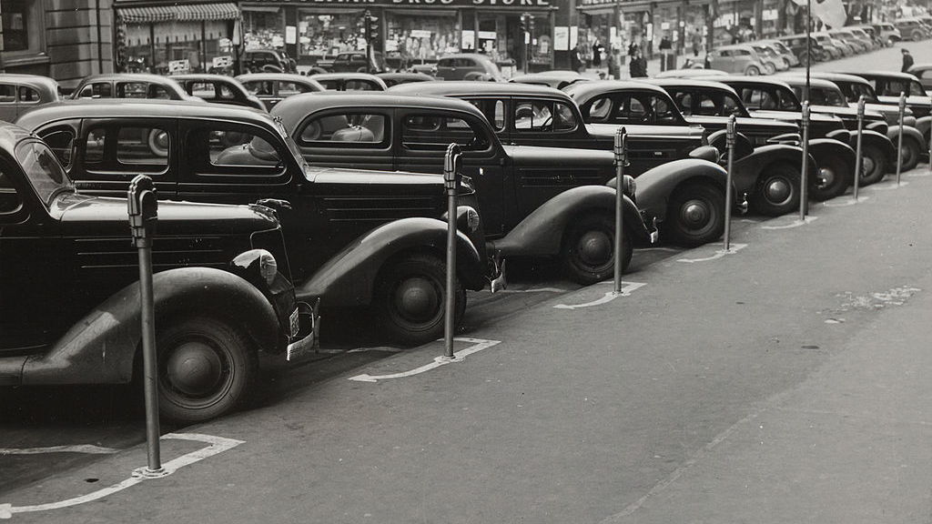 Cars parked diagonally along parking meters, Omaha, Nebraska, 1938 (via Wikimedia)