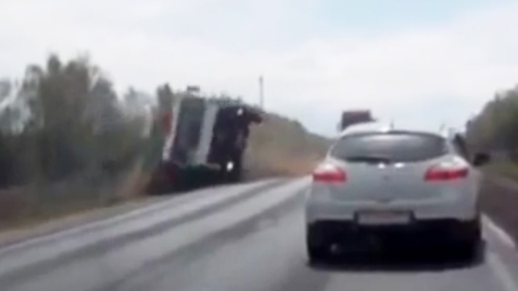 Speeding truck in Russia crashes and then does a backflip