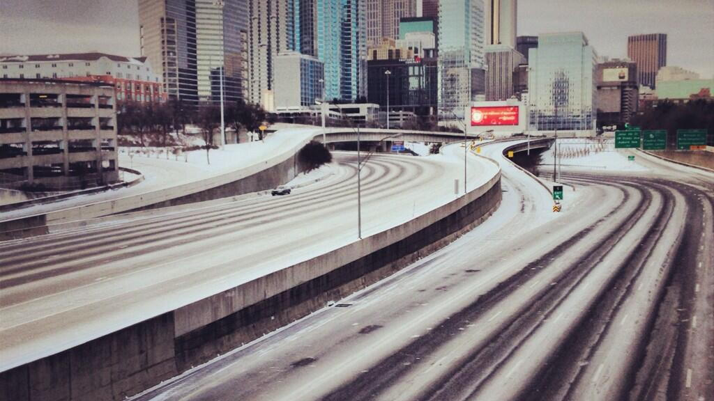 Downtown Atlanta in the snow. Image via @erikrostad on Twitter