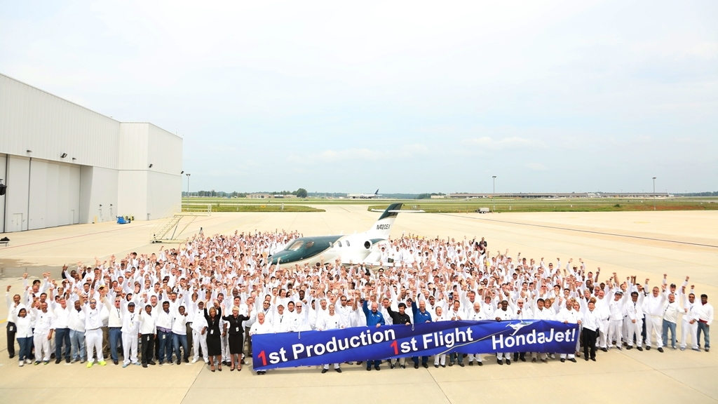 HondaJet employees celebrate the aircraft's maiden flight