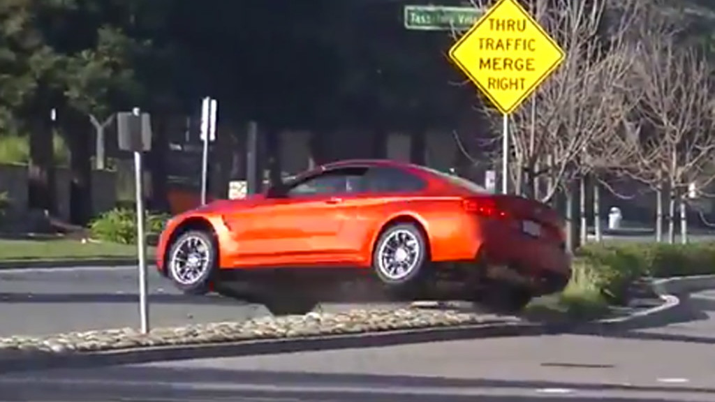 2015 BMW M4 jumps the median strip