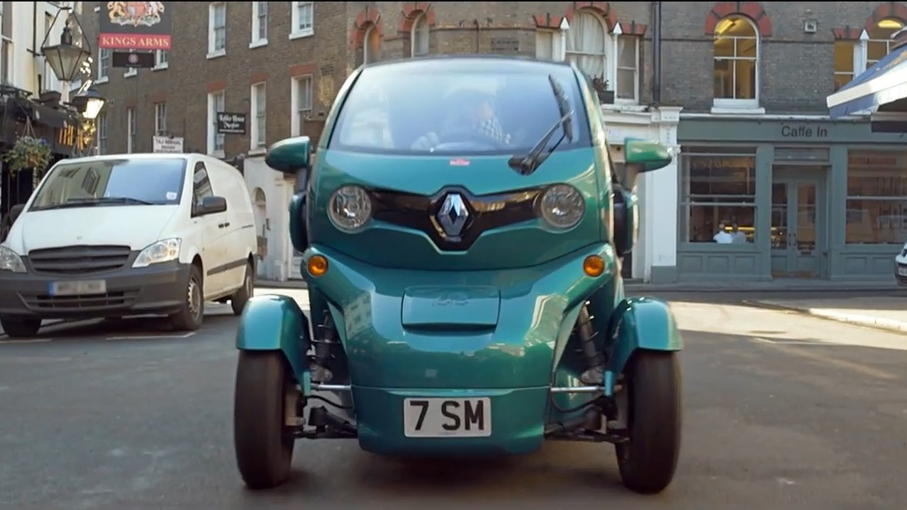 Sir Stirling Moss in his Renault Twizy electric car, London, May 2015