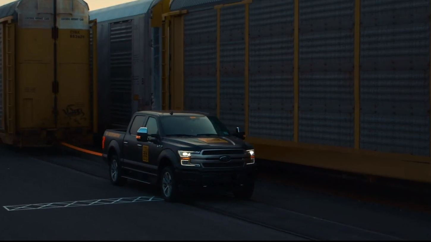 Ford F-150 electric prototype ready to pull train full of F-150s (From YouTube video)