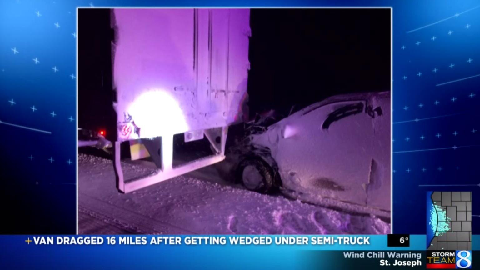 minivan wedged under semi