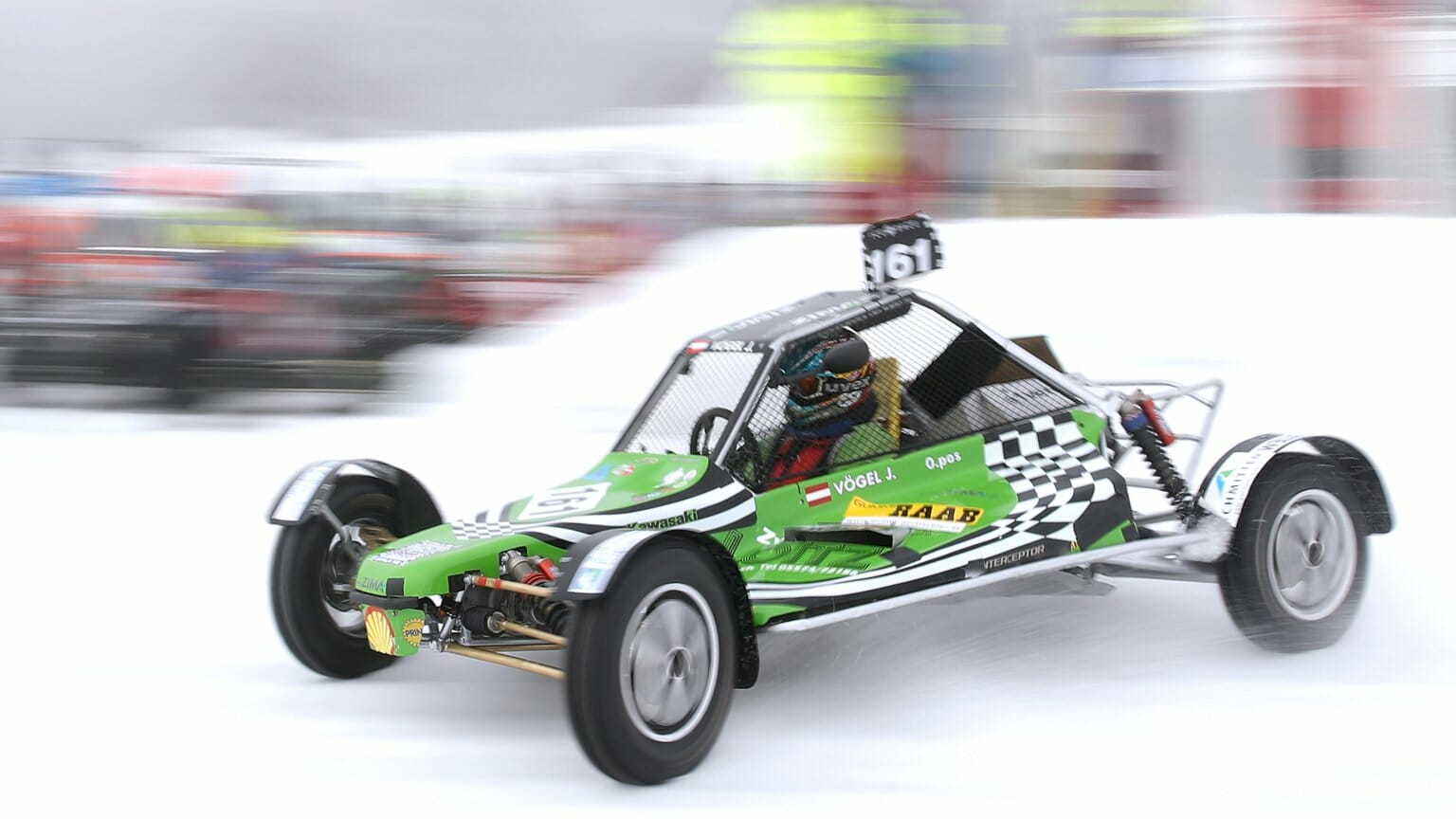 Buggy-style vehicle makes a run on the snow-covered track