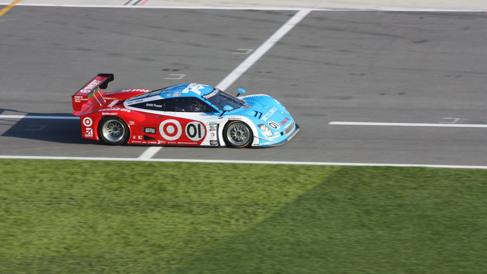 The 01 BMW Riley on Chip Ganassi Racing makes an early pit stop