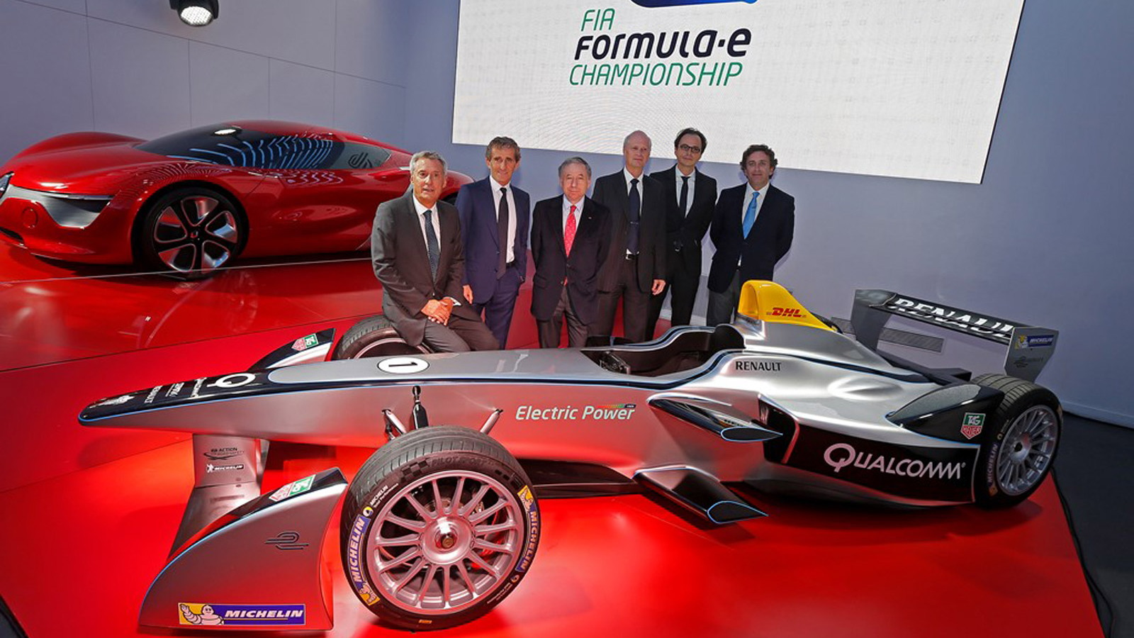 Alain Prost (second from the left) and the Spark-Renault SRT_01E