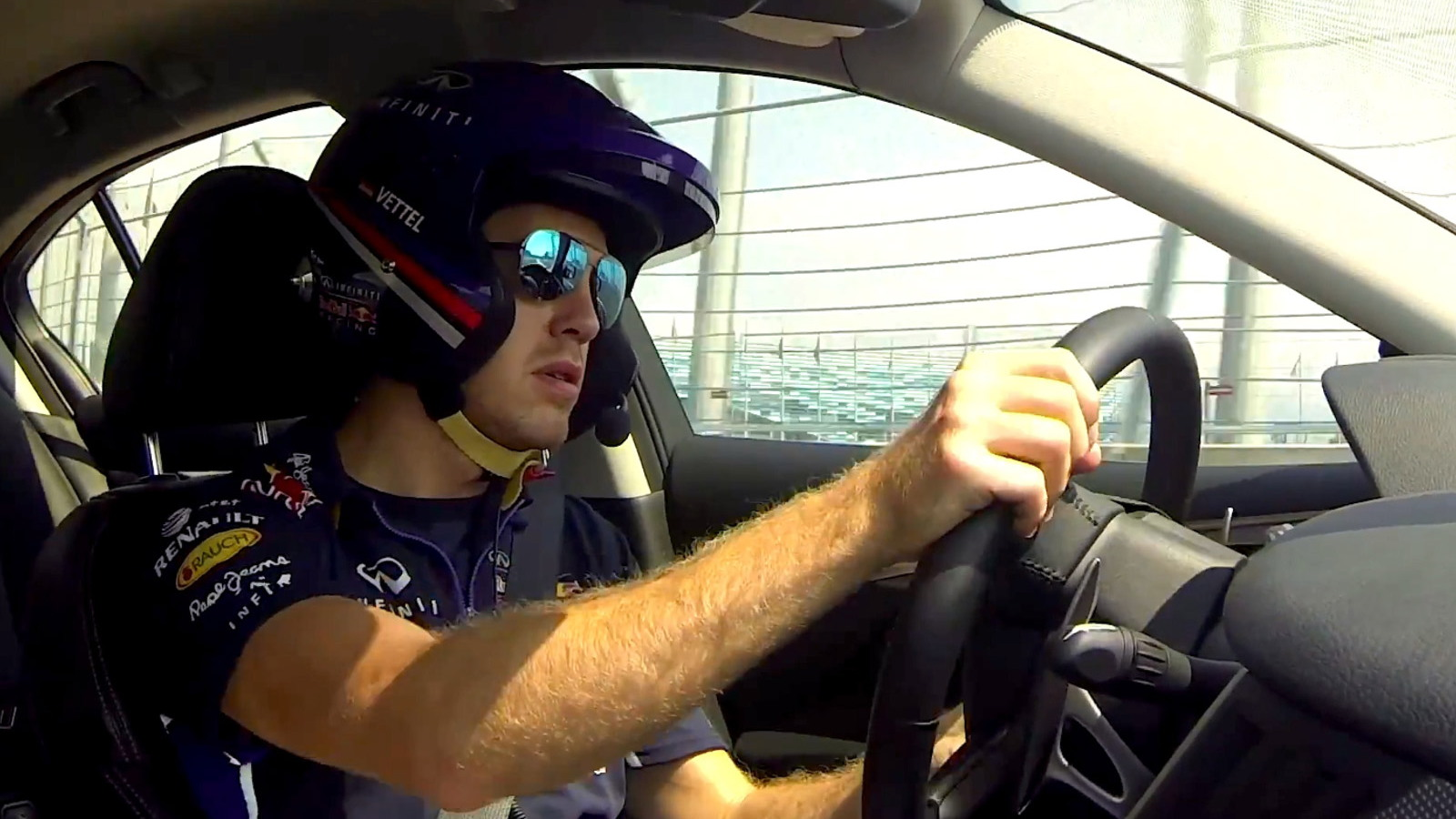 Sebastian Vettel driving Russia's Sochi Circuit in an Infiniti Q50 Hybrid