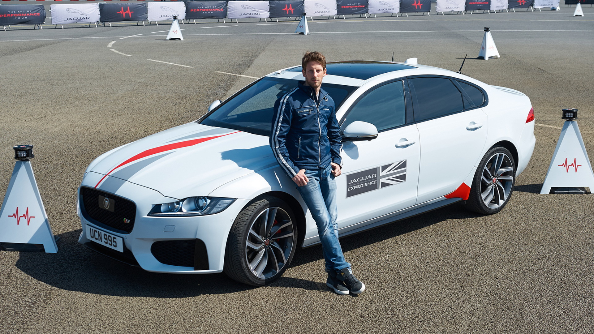 Haas Formula One driver Romain Grosjean and the 2016 Jaguar XF