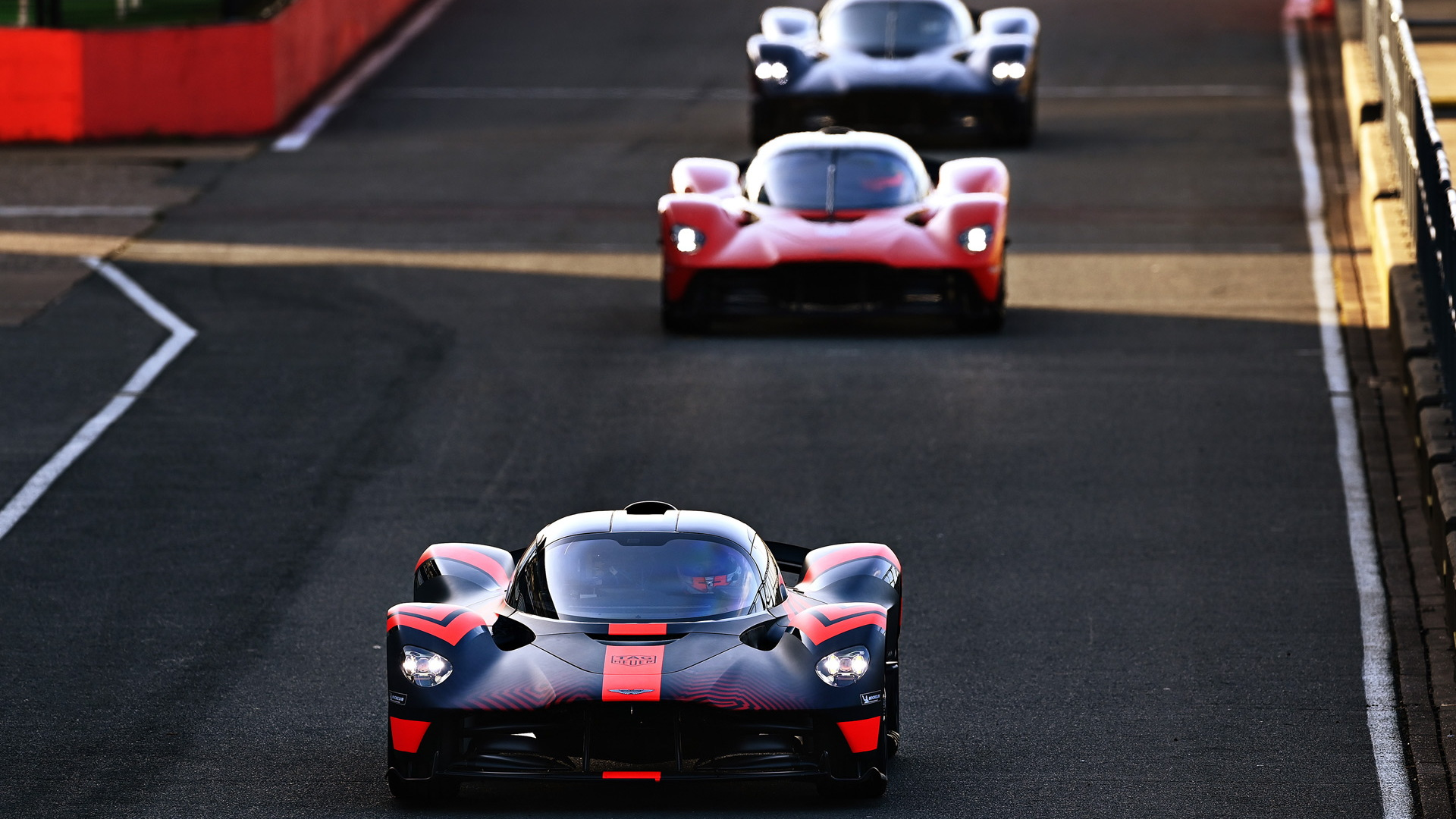 Red Bull Racing F1 drivers Max Verstappen (left) and Alex Albon test the Aston Martin Valkyrie