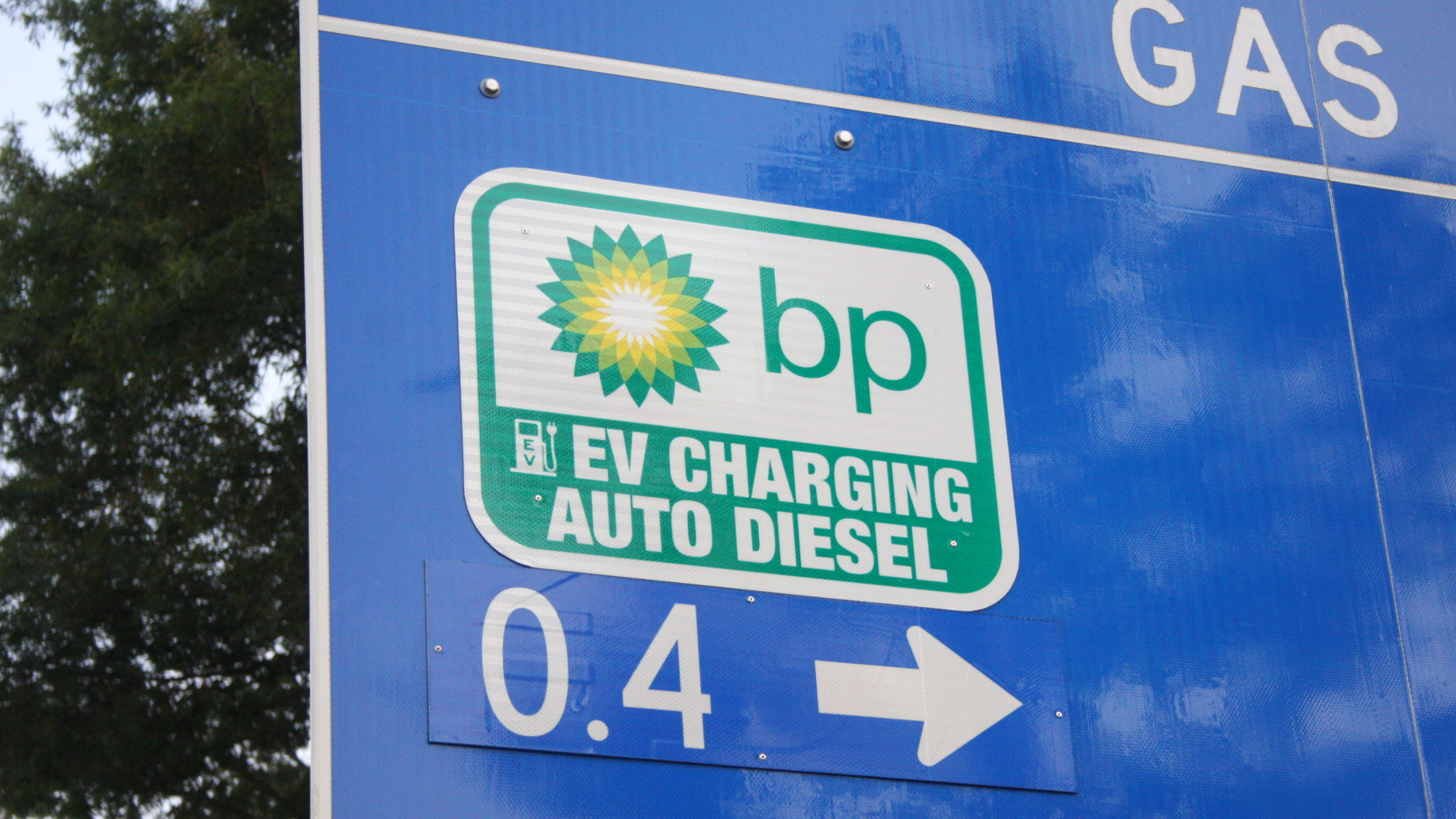 Highway sign for electric-car fast-charging station at BP in Metrolina area of Charlotte, NC