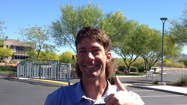 Travis Pastrana wearing a mullet given by Jimmie Johnson