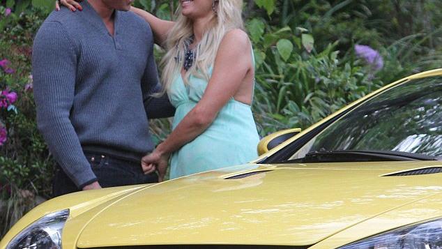 Cy Waits presents Paris Hilton with her birthday LFA