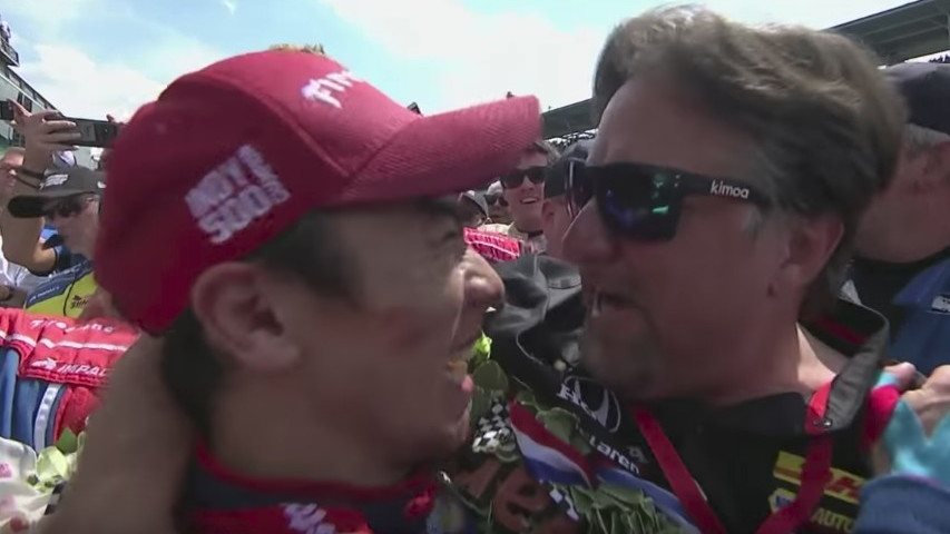 Takuma Sato and Michael Andretti embrace at the end of the Indy 500