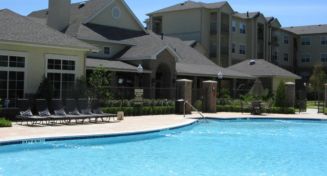 Large community pool with lounge seating
